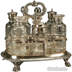 Castor set 7 Bottles Cut Glass Silver On Copper Frame Oval Handle 4 Paw Feet | Kovels' Price Guide