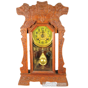 Clock New Haven Wall Oak Carved Lions Heads Flowers Shaped Sides Glass Door | Kovels' Price Guide