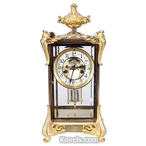 Clock Waterbury Regulator Crystal Gilt Brass 8-Day c1908 | Kovels' Price Guide