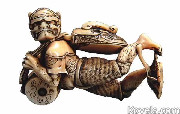 netsuke-ivory-oni-acrobatic-pose-si112214-0208.jpg