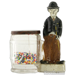 Charlie Chaplin Candy Container Glass Painted Coin Slot Borgfeldt Dist | Kovels' Price Guide