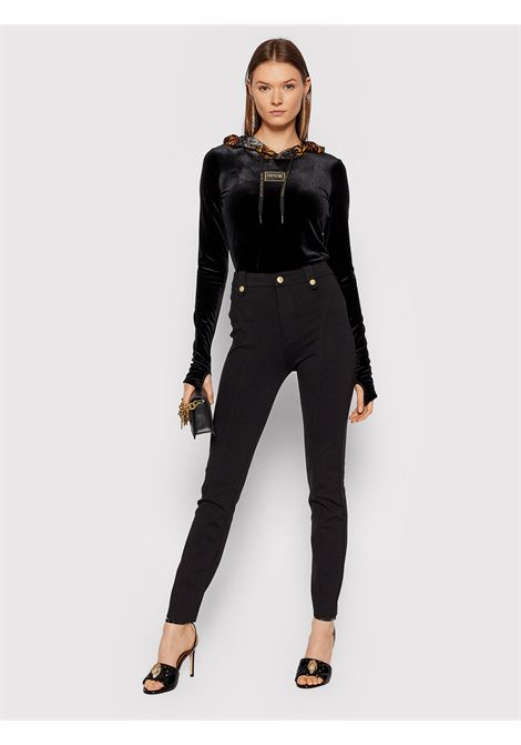 Trousers stretch gold VERSACE JEANS | Trousers | 71HAA109899