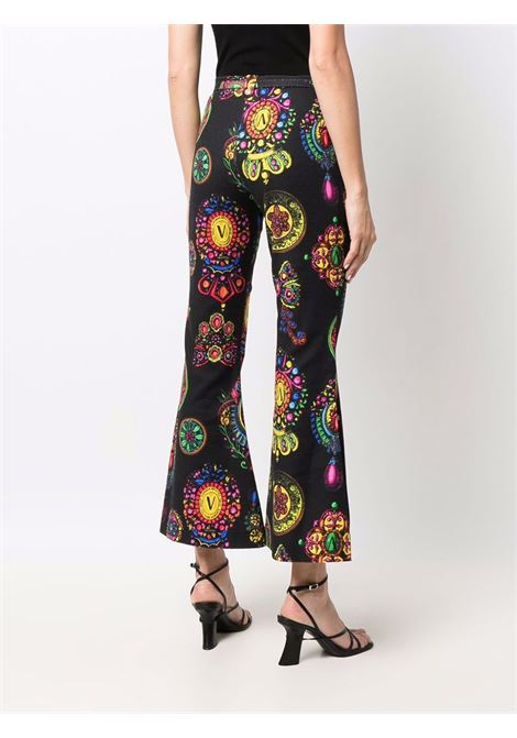 Trousers flared Crystal  VERSACE JEANS | Trousers | 71HAA111899