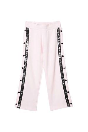 White teen trousers with black side band with logo Balmain kids BALMAIN KIDS | 9 | 6M6527MA010502NET