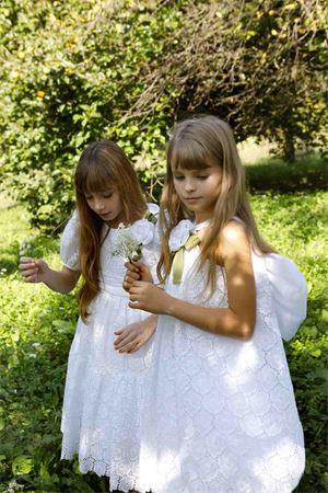 White balloon dress in lace Alabastro model with flower applied on the front and rear bow Raffaella RAFFAELLA | 11 | ALABASTRO15PALL01