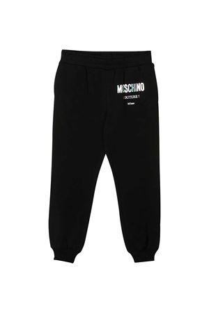 Pantalone sportivo teen nero con logo bianco Moschino kids MOSCHINO KIDS   9   HUP049LDA1660100T