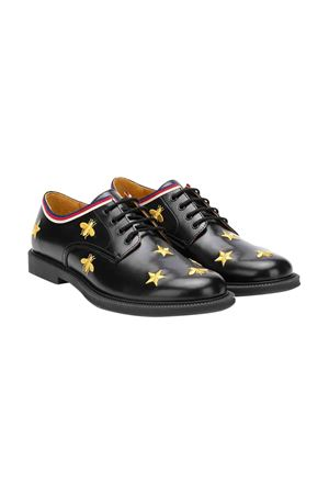 Scarpe con stelle e api applicate nero e oro in pelle di Gucci Kids GUCCI KIDS | 12 | 522656D73101066
