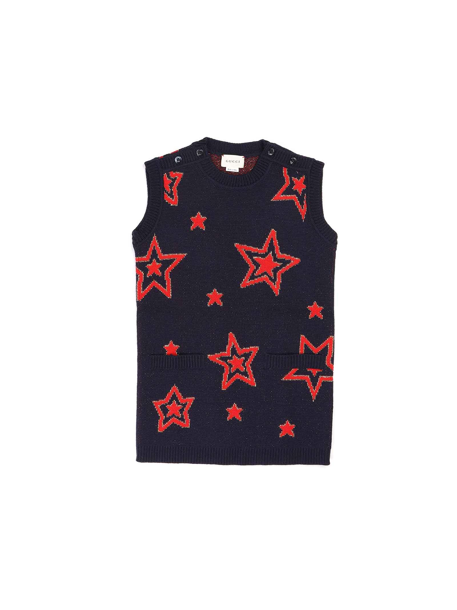 abito fondo blu con stelle e scritta sul retro rossa Gucci | Abito | 621856 XKBGX4696