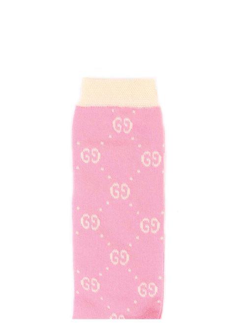 calzini fondo rosa con bordi e logo avorio Gucci | Calzini | 503509 4K5415878