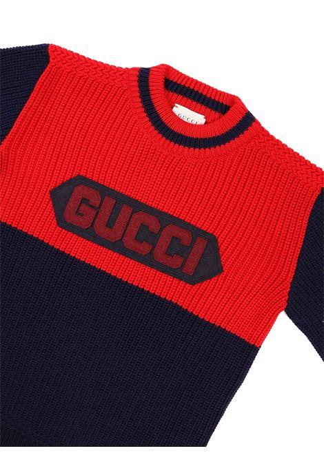 maglia blu e rossa con scritta Gucci | Maglia | 615672 XKBEE4210