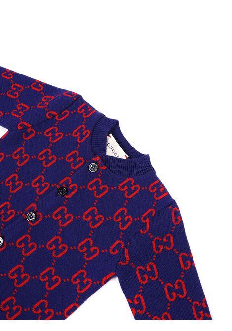 tutina fondo blu con logo rosso Gucci | Tutina | 621875 XKBGY4175
