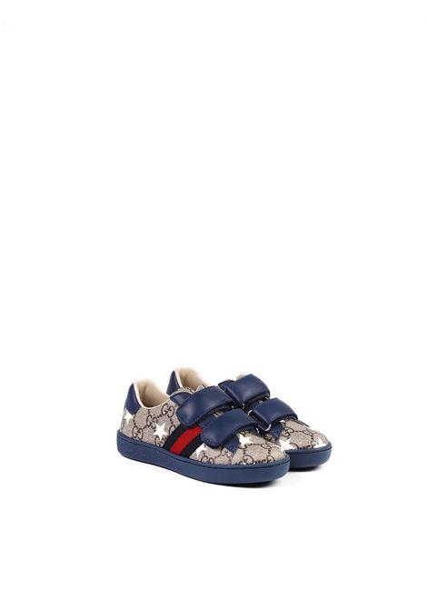 scarpe blu fondo beige con stelle e strisce laterali blu e rosse Gucci | Scarpe | 463088 HYY308485