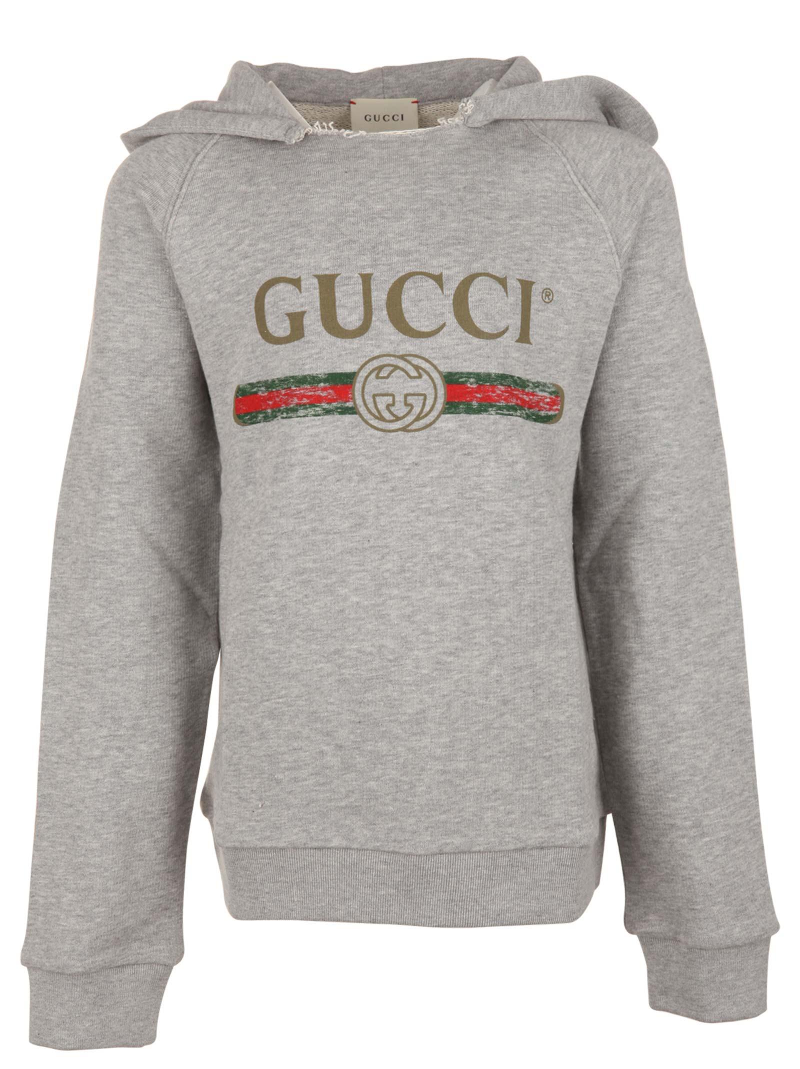 8bfa29f277 Gucci Junior. Felpa per bambini in cotone grigio con stampa logo vintage  frontale e cappuccio