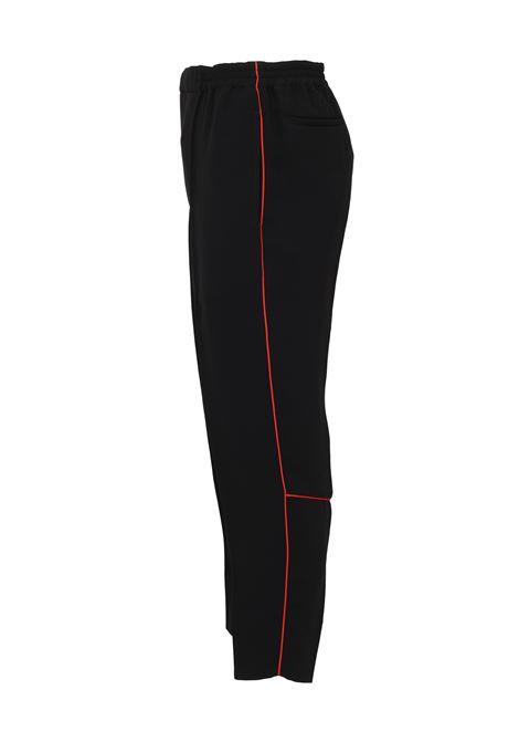 Alexander McQueen Trousers  Alexander McQueen | 1672492985 | 573705QNR381000