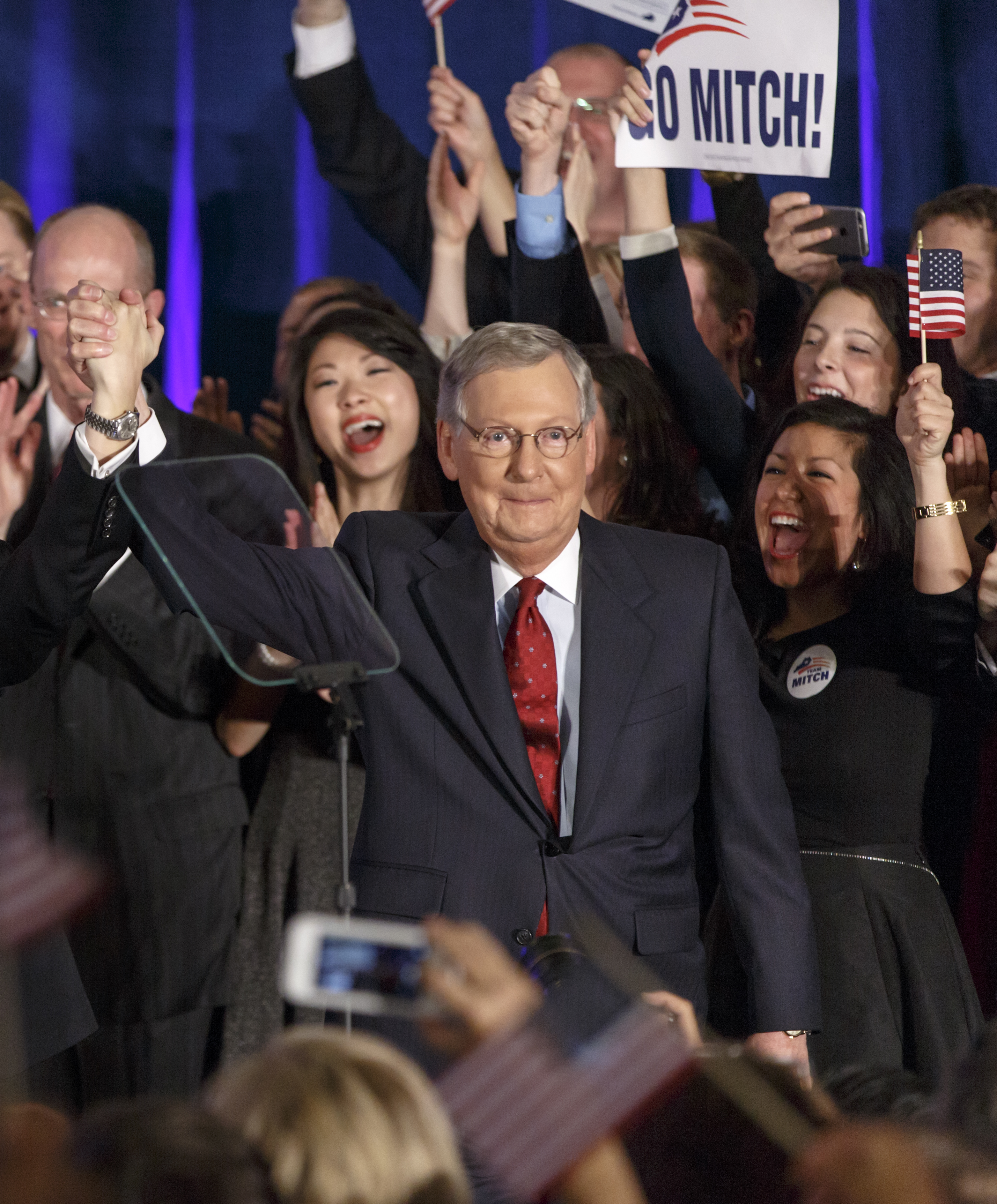 Senate Minority Leader Mitch McConnell, R-Ky., celebrates with his supporters at an election night... [+] party in Louisville, Ky.,Tuesday, Nov. 4, 2014. McConnell won a sixth term in Washington, with his eyes on the larger prize of GOP control of the Senate. The Kentucky U.S. Senate race, with McConnell, a 30-year incumbent, fighting off a spirited challenge from Democrat Alison Lundergan Grimes, has been among the most combative and closely watched contests that could determine the balance of power in Congress. (AP Photo/J. Scott Applewhite)