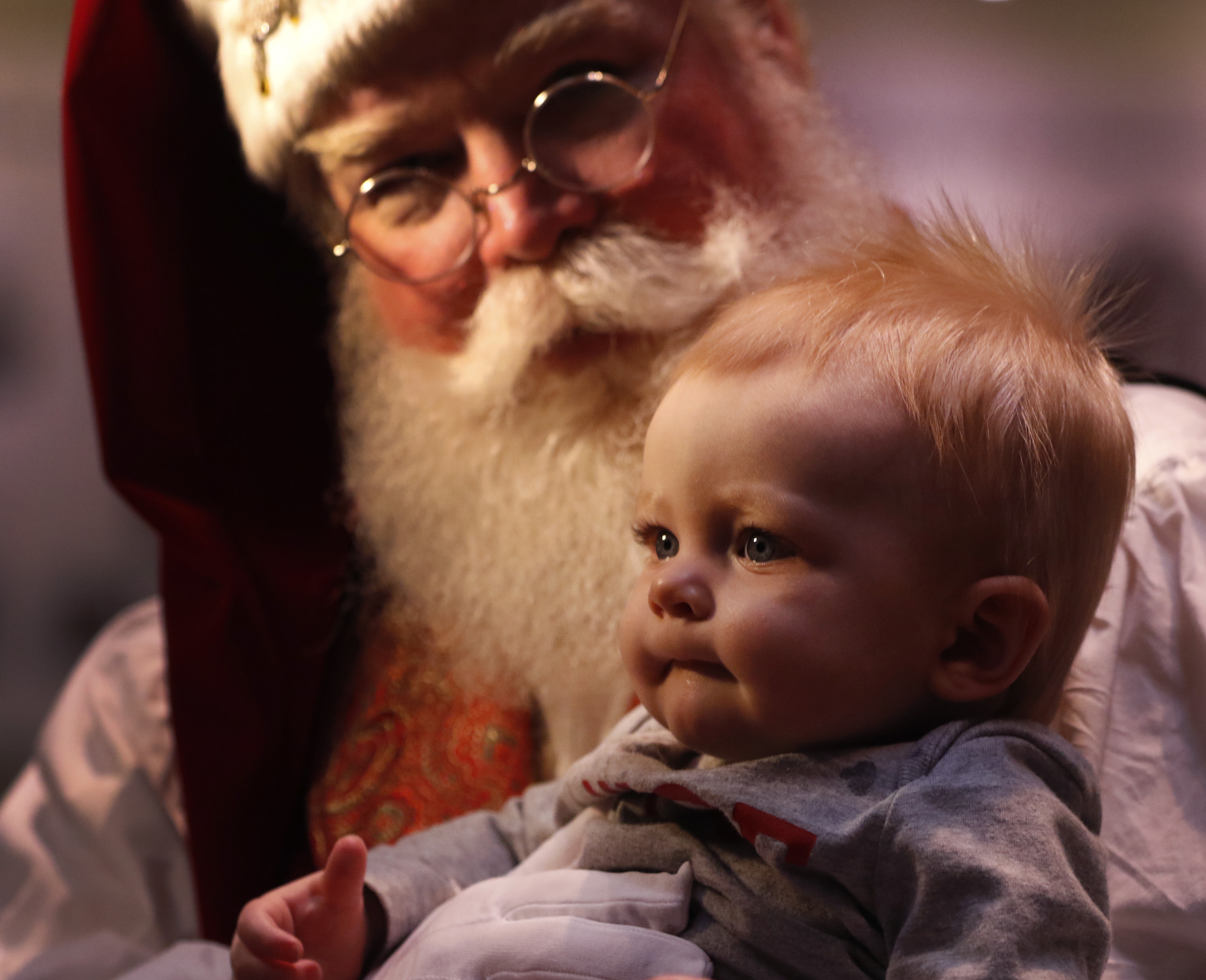 Chuck Lee, a part-time Santa Claus, holds 10-month-old Liam Holzer in the lobby at Baylor University... [+] Medical Center in Dallas on Dec. 19, 2014. Lee lost a total of 50 pounds after some health issues made him want to lead a healthier lifestyle. (AP Photo/The Dallas Morning News, Rose Baca)