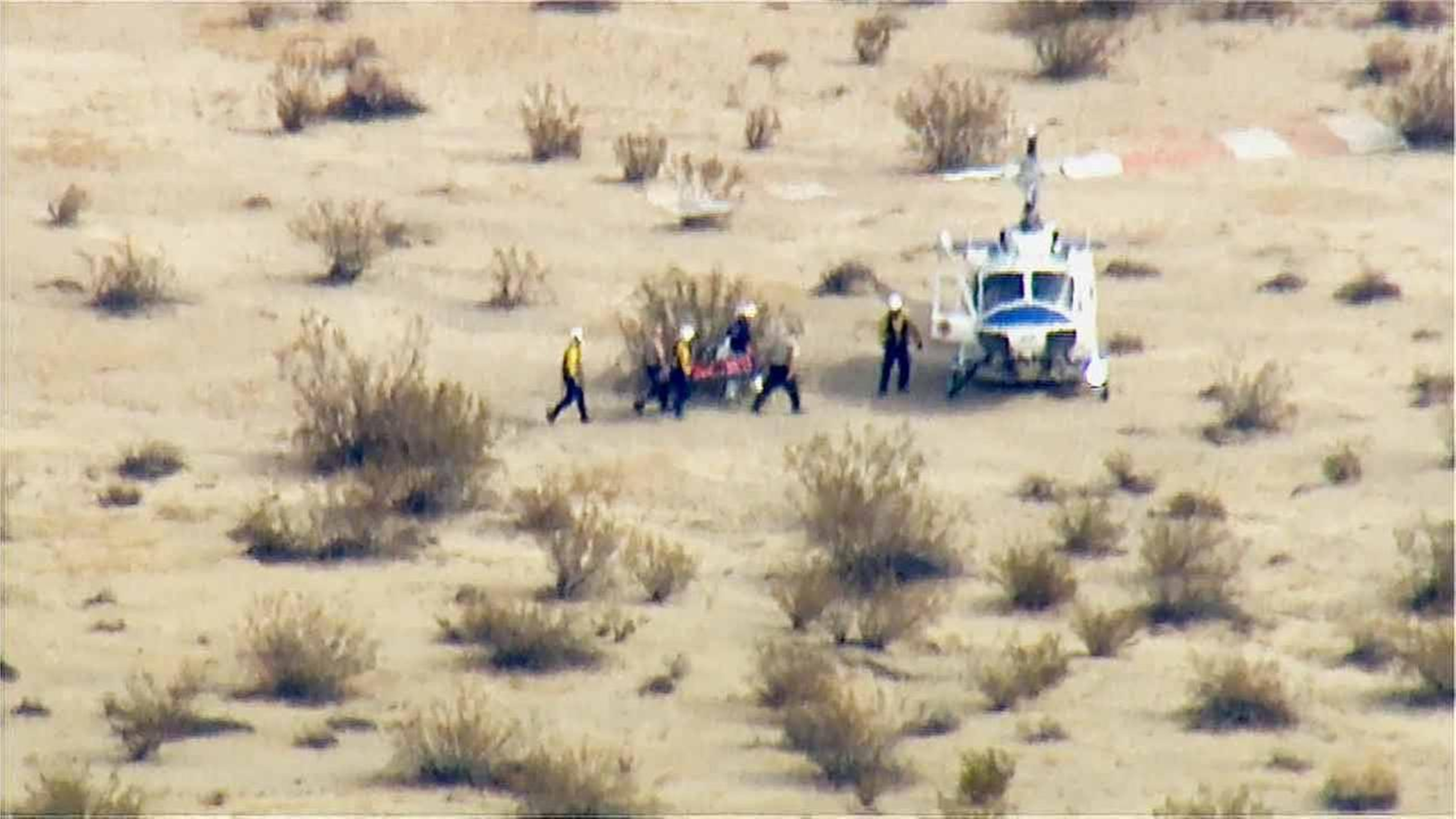 In this image from video by KABC-TV Los Angeles, a rescue crew carries a person on a stretcher to a... [+] waiting helicopter near the scene of a crash of the SpaceShipTwo in Southern California's Mojave Desert on Friday, Oct. 31, 2014. (AP Photo/KABC-TV)