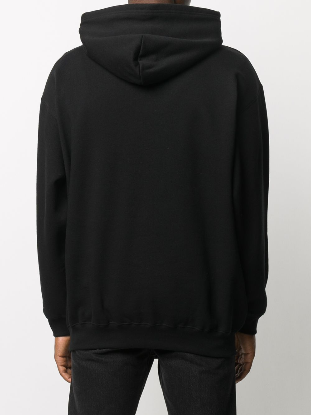 Black cotton hoodie featuring drawstring hood and white Balenciaga logo BALENCIAGA |  | 570811-TJVE11034