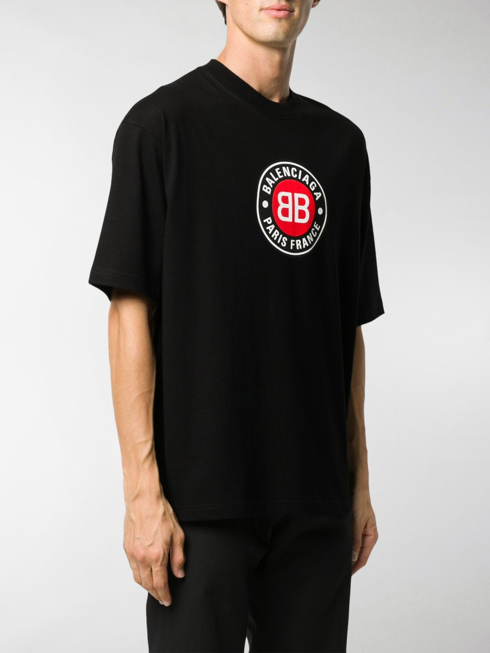 Black cotton relaxed-fit t-shirt featuring circular Balenciaga Paris logo print  BALENCIAGA      612966-TJVD61000