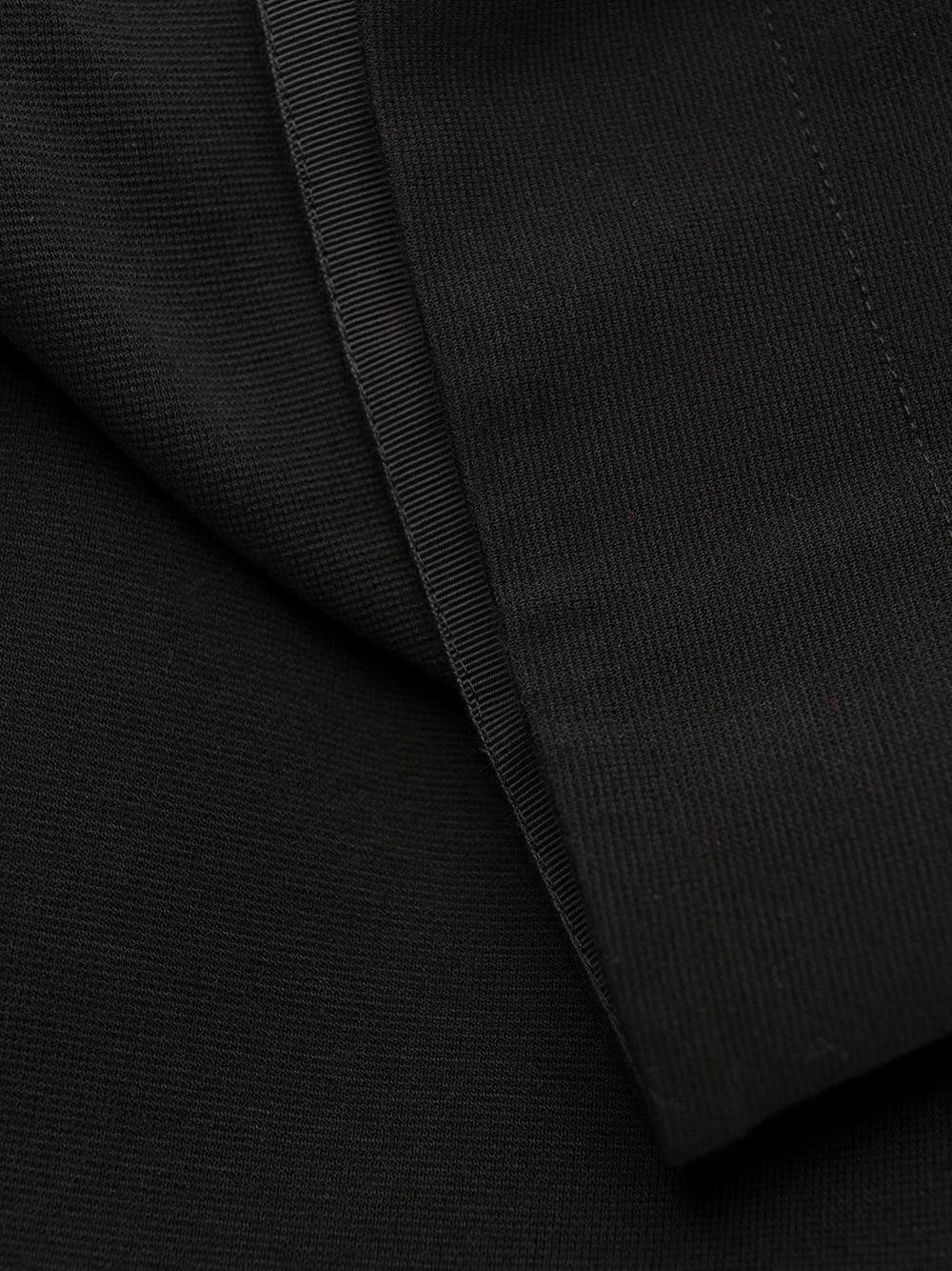 abito nero in poliammide destrutturato con scollo a V caratterizzato da bottoni decorativi dorati sulla spalla GIVENCHY | Abiti | BW20YM30J6001