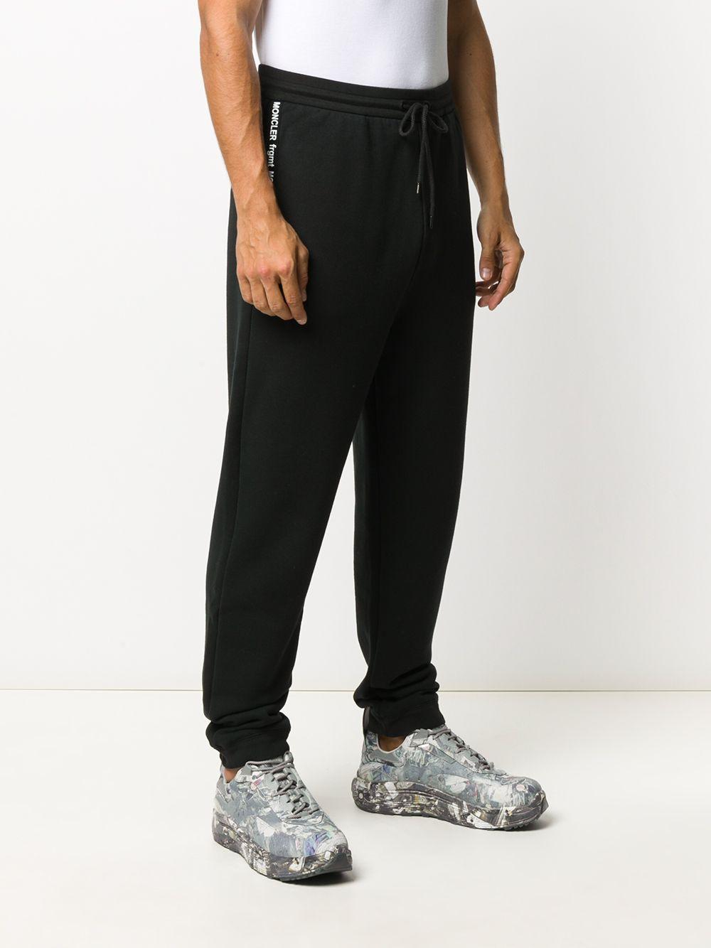 pantalone tuta in cotone nero con loghi laterali bianchi Moncler Genius x Fragment Design MONCLER GENIUS | Pantaloni | 8H701-00-809F4999