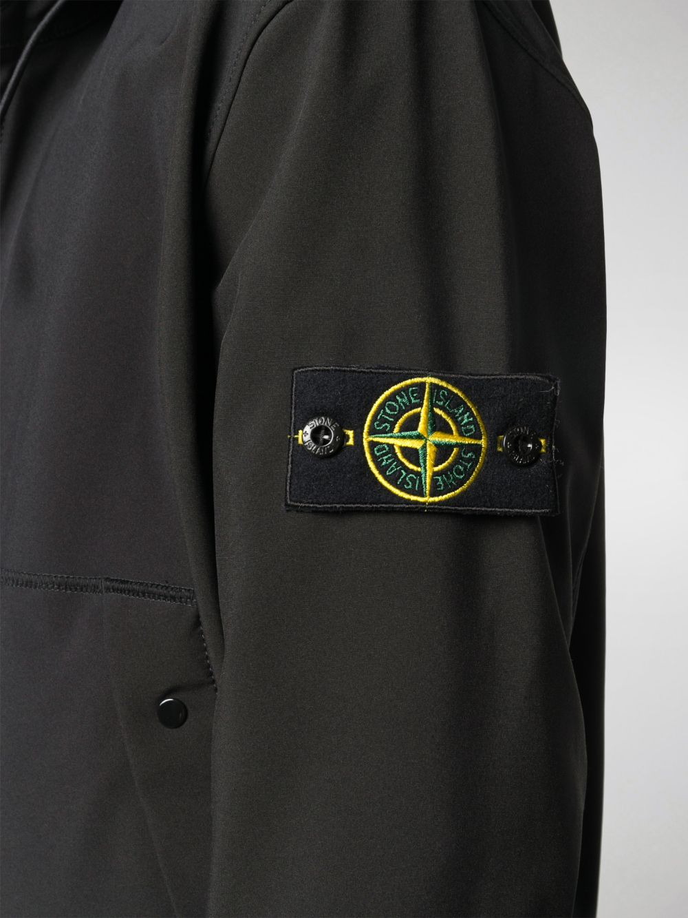 Black hooded jacket from featuring Stone Island compass logo patch at the sleeve STONE ISLAND      7315Q0122V0029