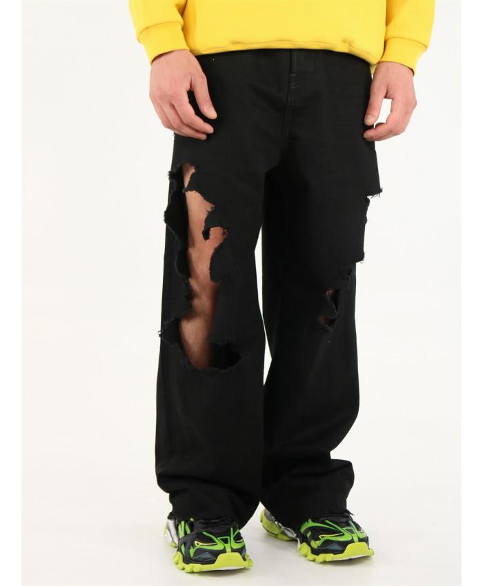 jeans nero in denim giapponese biologico ripped all over BALENCIAGA   Pantaloni   664265-TJW582470