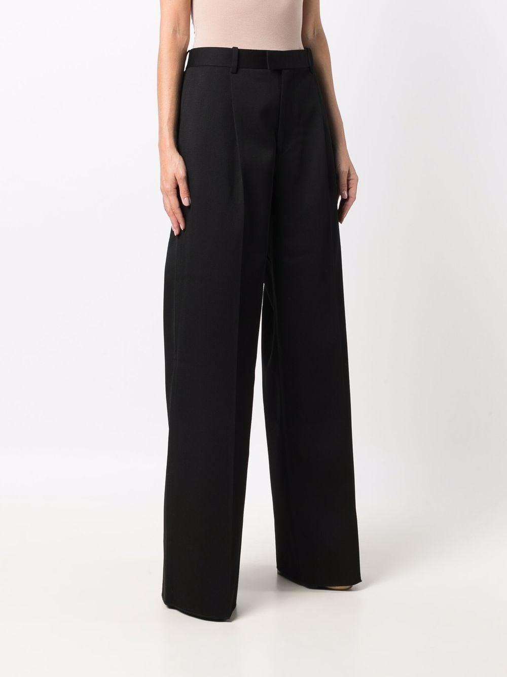 Pantaloni sartoriali a gamba larga in lana nera a vita alta BOTTEGA VENETA | Pantaloni | 668760-V0B201000