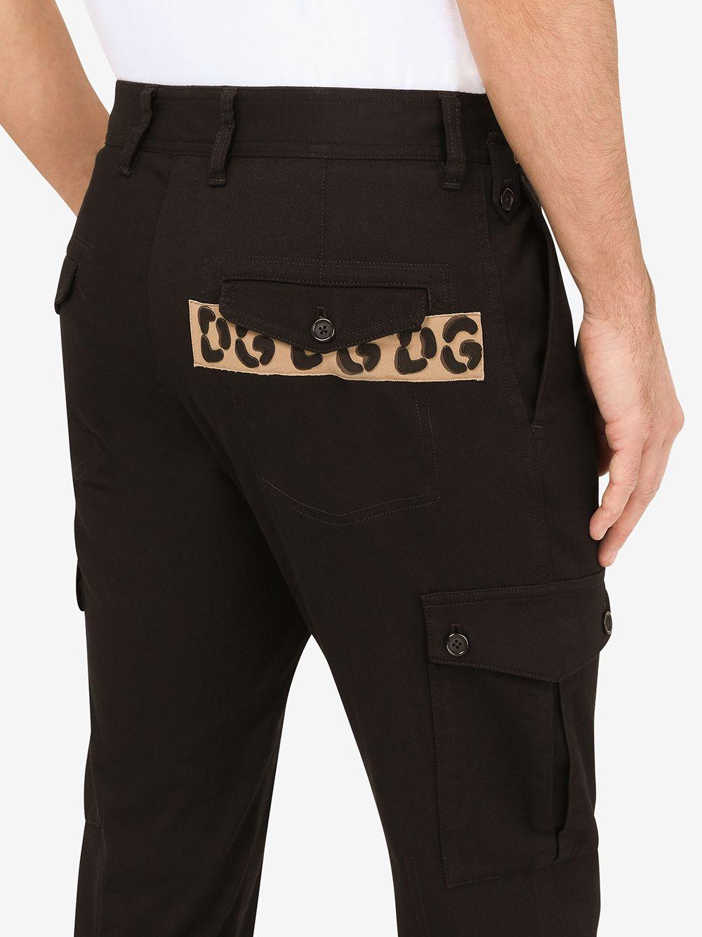 pantalone slim fit in cotone nero e pannelli a contrasto leopardati DOLCE & GABBANA | Pantaloni | GYA8EZ-FUFJUN0000