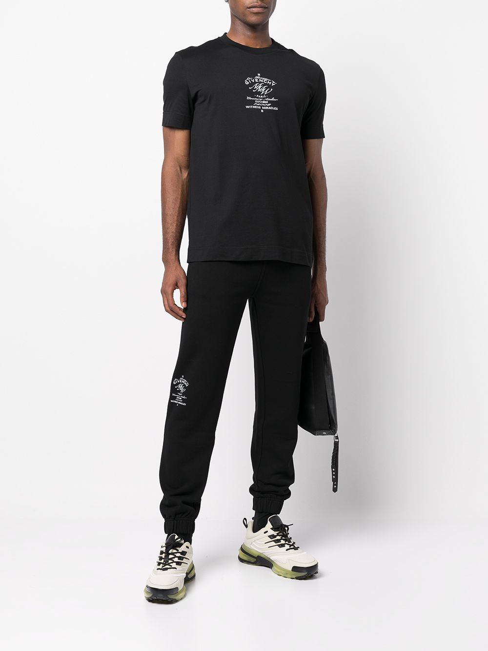 Black cotton track pants featuring Givenchy logo print to the side GIVENCHY |  | BM50Y63Y6V001