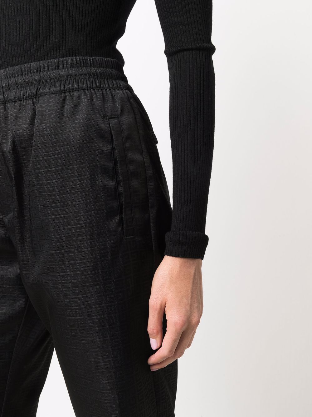Black elasticated-waist trousers featuring 4G all over monogram print GIVENCHY |  | BW50R513PK001