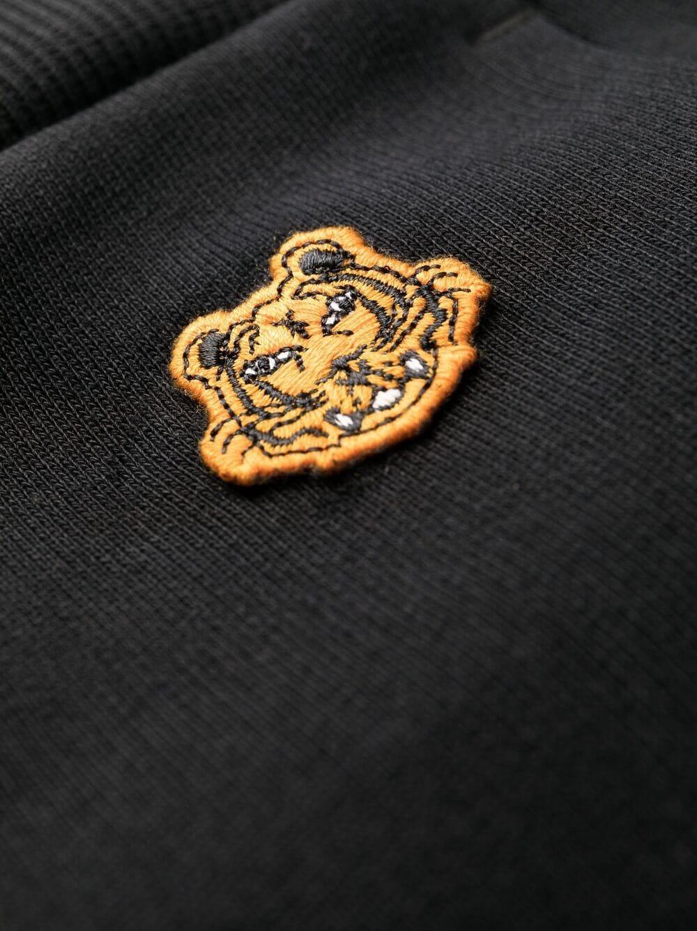Pantaloni sportivi neri in cotone a gamba slim con patch logo Tiger KENZO | Pantaloni | FB5-2PA722-4ML99