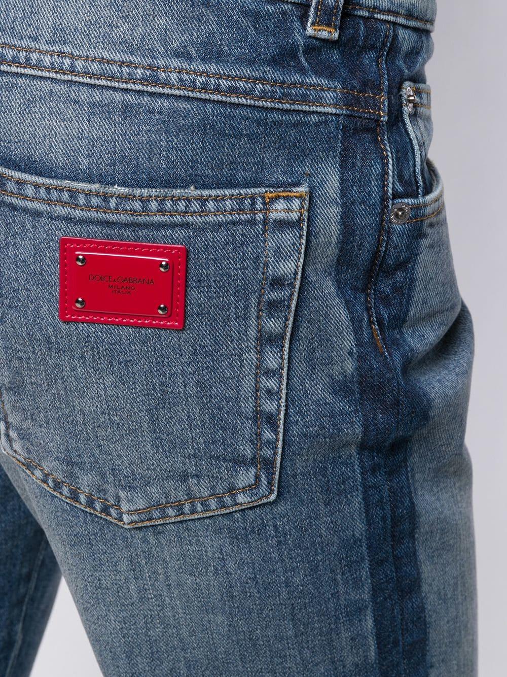 asymmetric cropped vintage effect blue jeans DOLCE & GABBANA |  | FTA0PD-G8V47S9000