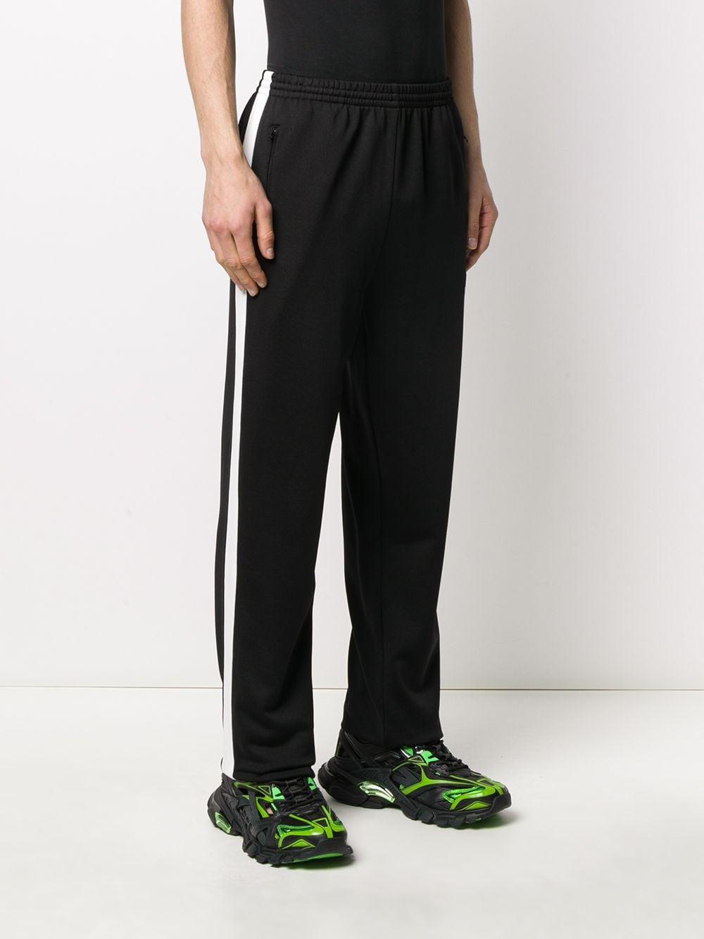 black track pants with side white stripe BALENCIAGA |  | 601609-TGV041070