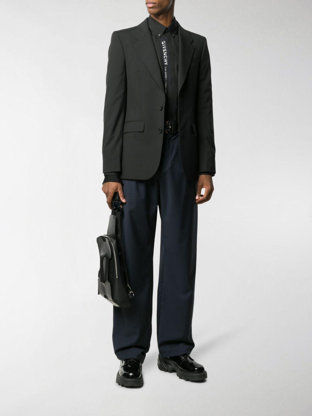 giacca di lana nera a due bottoni con taschino logato Givenchy in bianco GIVENCHY | Giacche | BM307P100B001