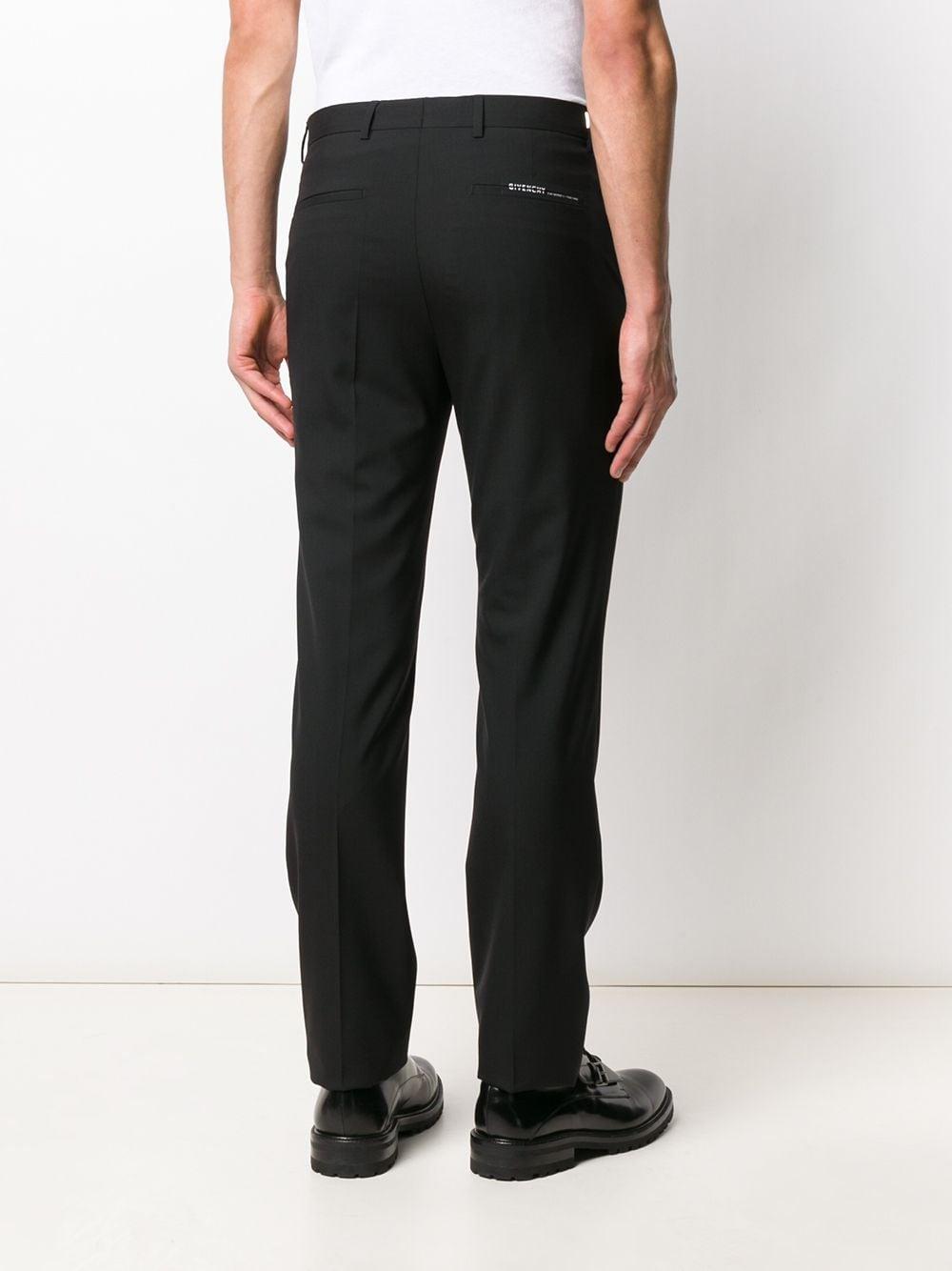 pantalone classico dritto in lana nera con logo Givenchy sulla tasca posteriore GIVENCHY | Pantaloni | BM50K0100B001