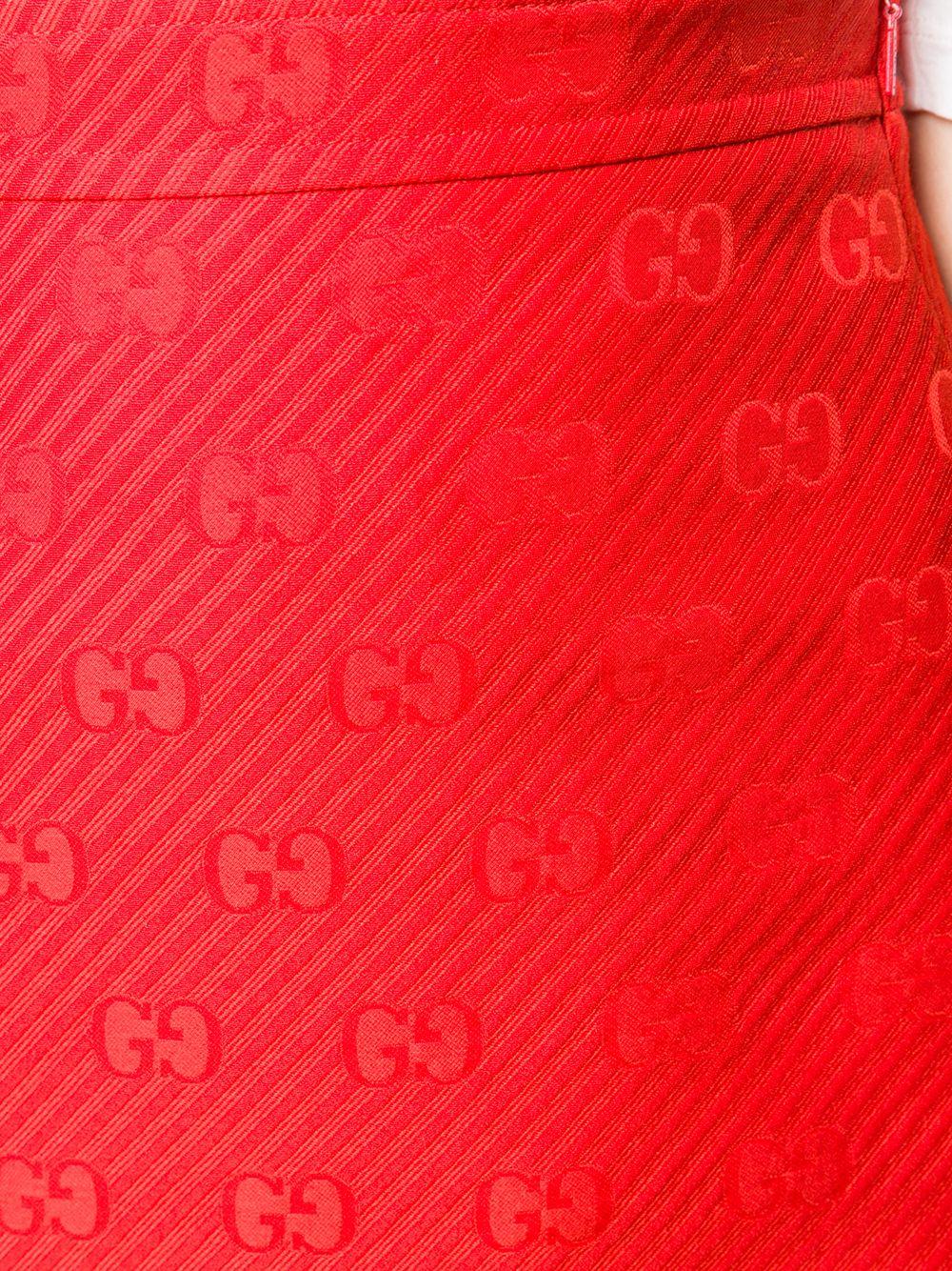 gonna corta rossa svasata con logo GG monogram GUCCI | Gonne | 609775-ZADC76049