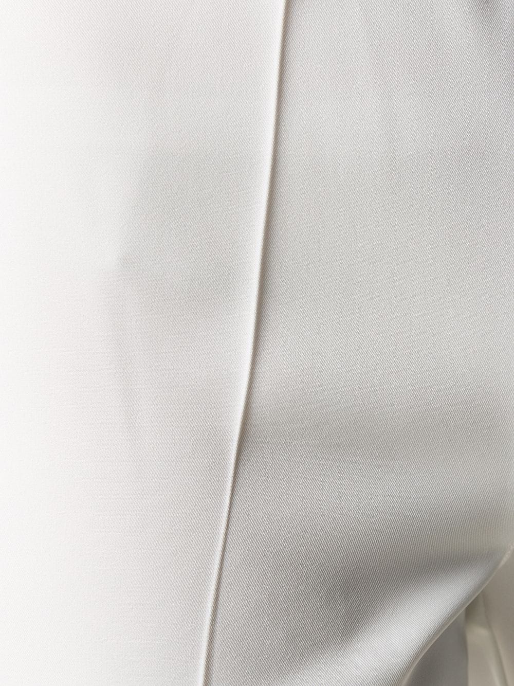 White mid-rise slim fit trousers featuring an elasticated waistband P.A.R.O.S.H. |  | D220003X-PLIK002