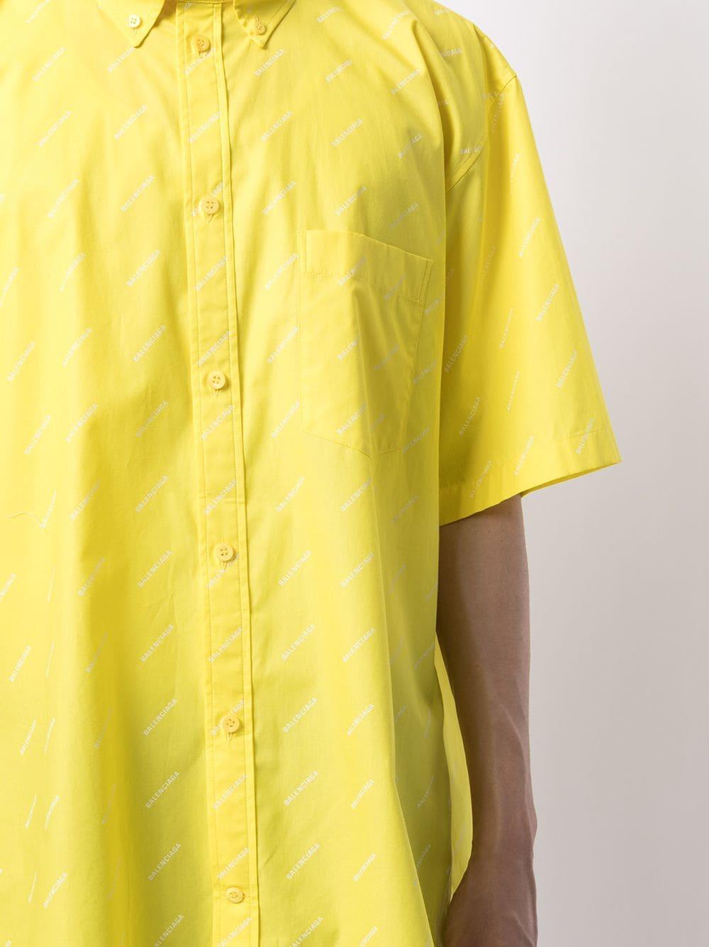 Camicia oversize in popeline di cotone giallo con logo all over Balenciaga BALENCIAGA   Camicie   534332-TBL967201