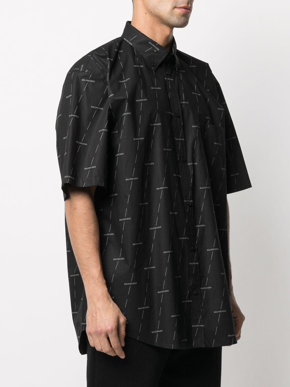 Black cotton short-sleeve shirt featuring white all-over Balenciaga logo print BALENCIAGA |  | 534332-TJLF31269