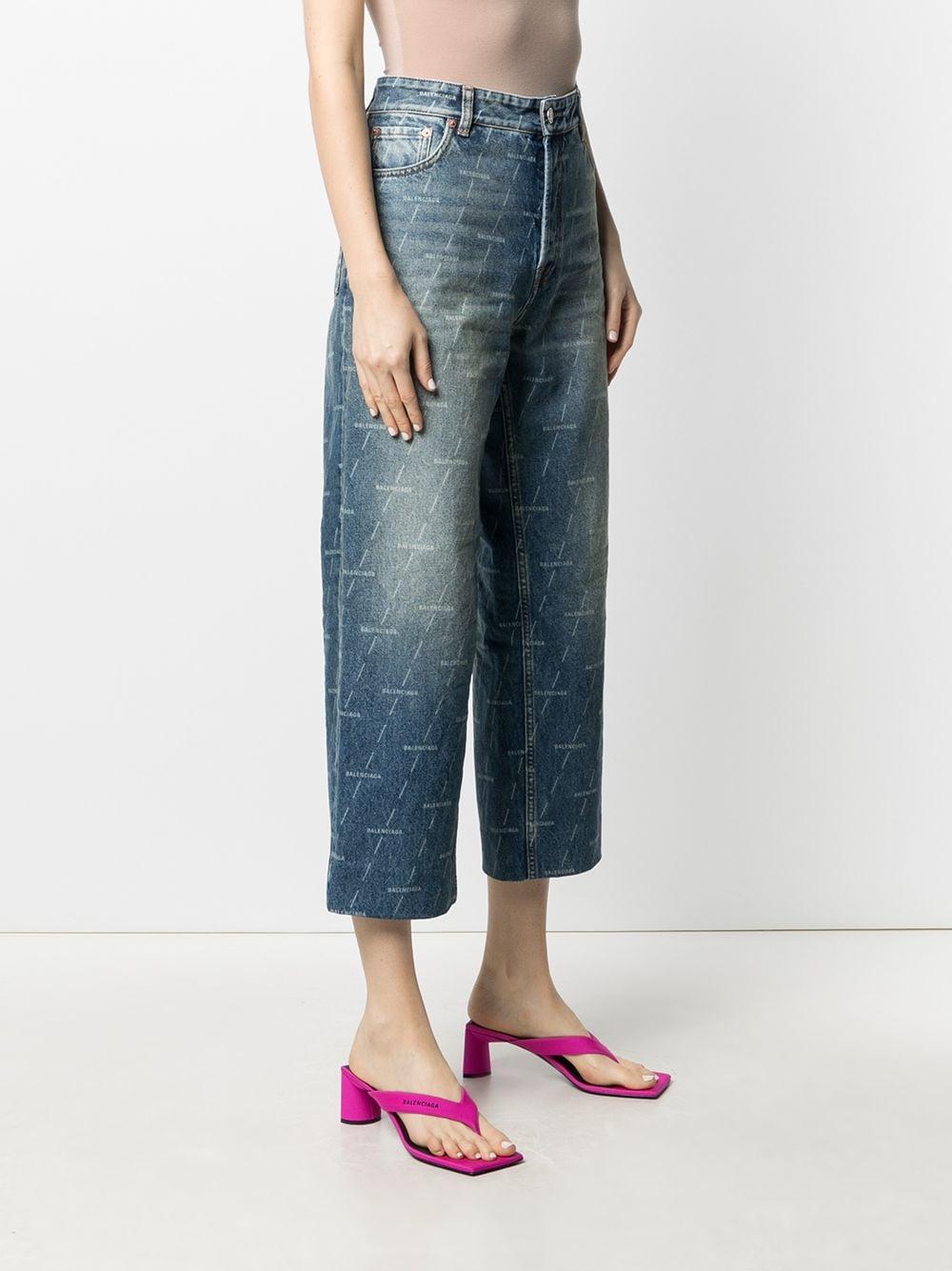 Blue cotton cropped jeans featuring all-over Balenciaga logo print BALENCIAGA |  | 600235-TJW532340