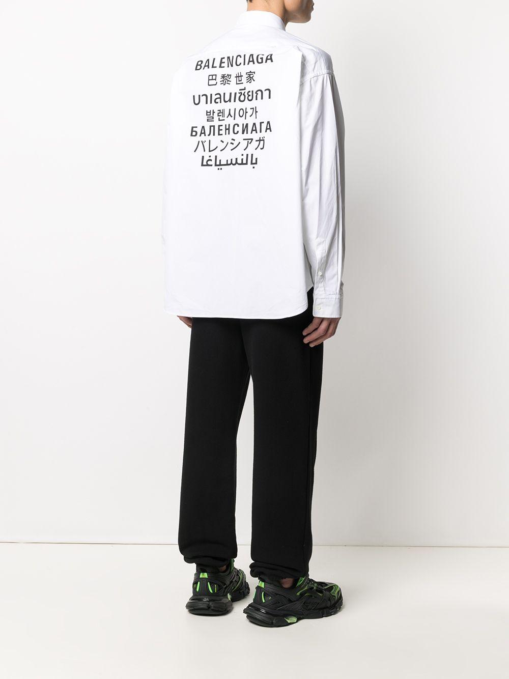 Camicia button-down Languages in cotone bianco con stampa Balenciaga multilingua nera sul retro BALENCIAGA | Camicie | 647357-TYB189000