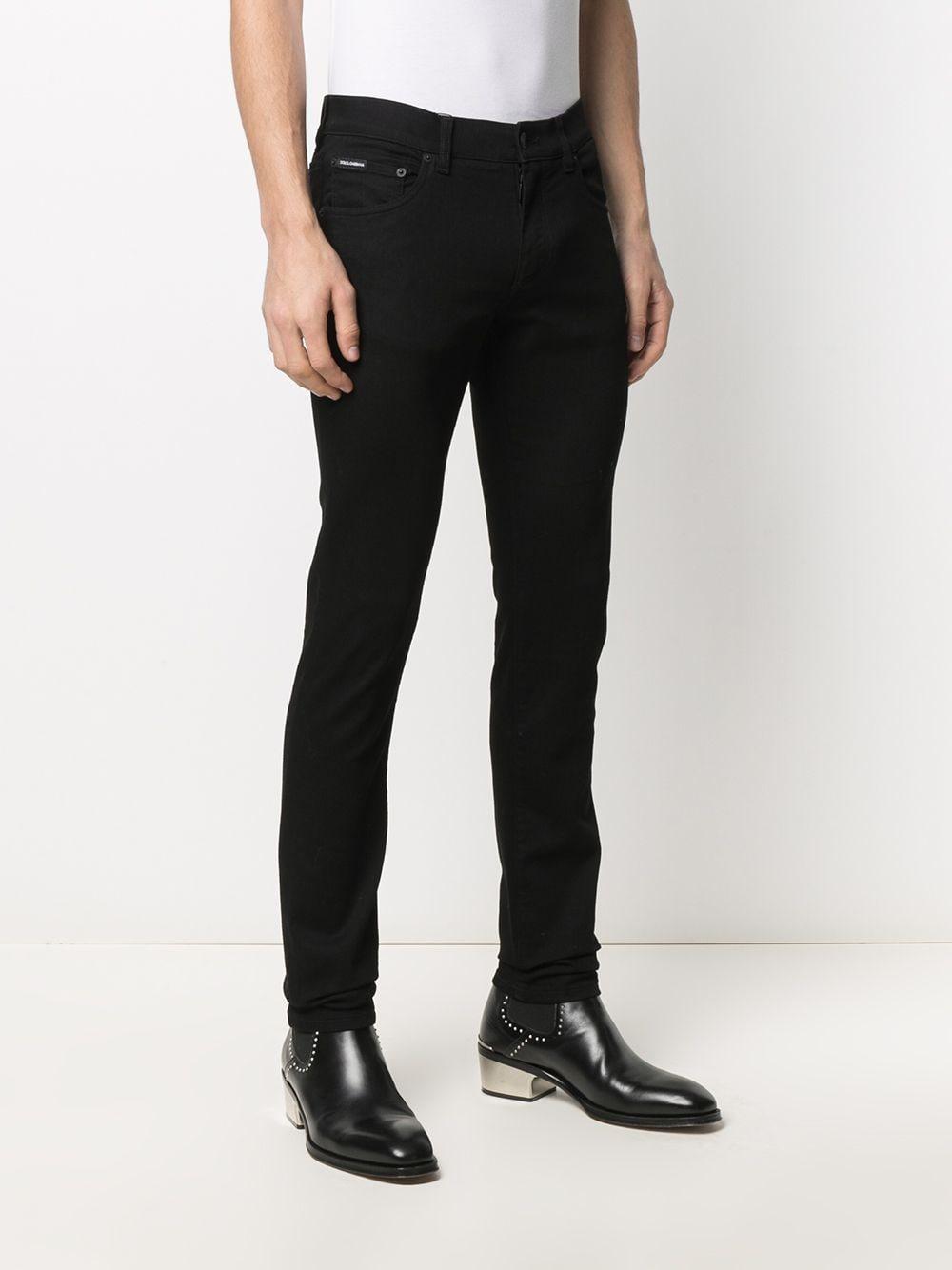 Jeans skinny in cotone elasticizzato nero con toppa in rilievo con logo Dolce & Gabbana DOLCE & GABBANA | Pantaloni | GY07LZ-G8DK3S9001