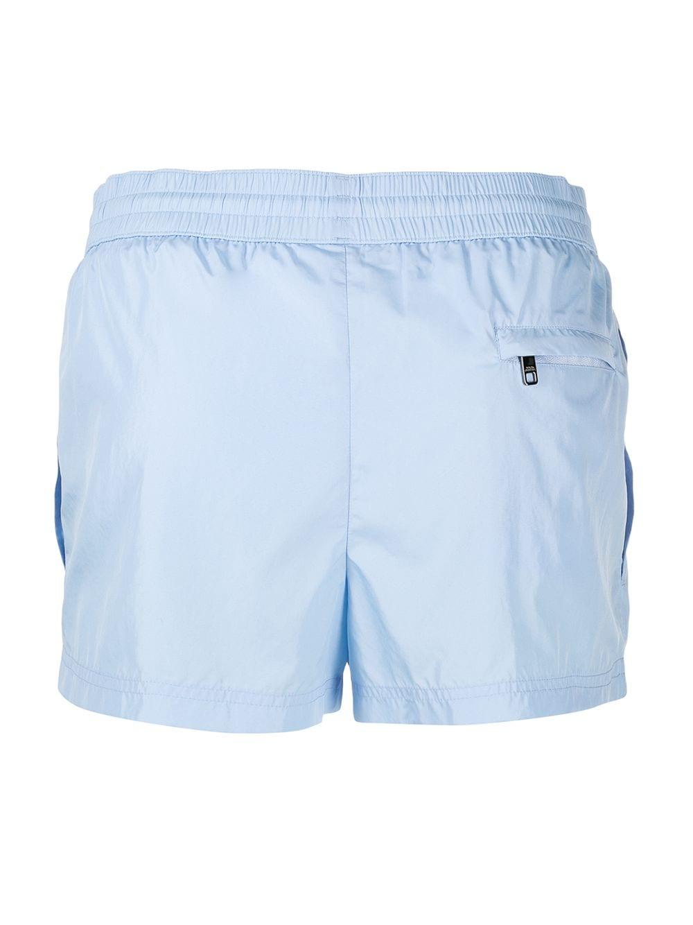 Costume da bagno azzurro con patch Dolce & Gabbana sul lato DOLCE & GABBANA | Costumi | M4B11T-FUSFWB1581