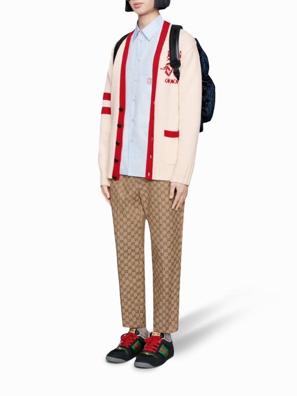 pantaloni beige e marroni in cotone con stampa GG Gucci all over GUCCI | Pantaloni | 569769-ZKU092580