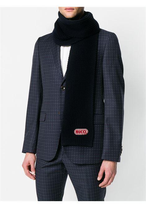 sciarpa in lana a coste 15x180 con patch logo Gucci in feltro e gomma GUCCI | Sciarpa | 527811-4G2064100