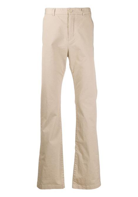 chino a gamba svasata in cotone elasticizzato beige BALENCIAGA | Pantaloni | 556696-TDP099501