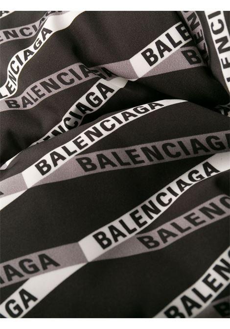 black hooded puffer jacket with all over Balenciaga printed logo BALENCIAGA |  | 556725-TEL211240
