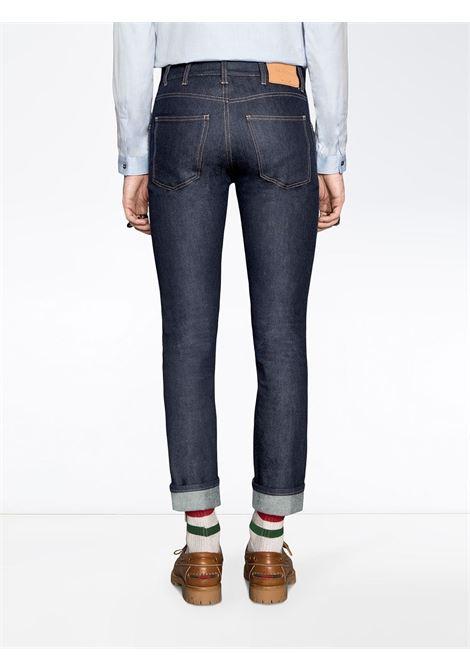 jeans 5 tasche slim fit con risvolto con dettaglio Gucci Web GUCCI   Pantaloni   430368-XR1884393