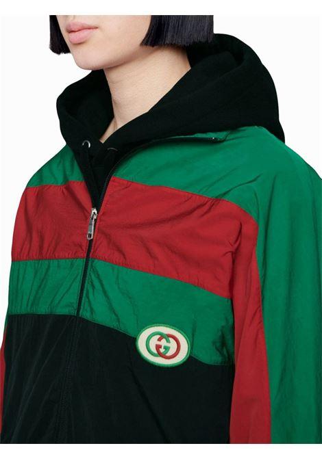 giacca vintage oversize in nylon nero, verde e rosso con toppa GG GUCCI | Giubbini | 573308-XJBAK1060